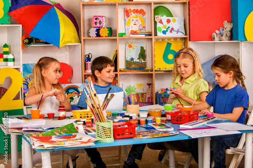 small students painting in art school class children boy and girl drawing by paints on