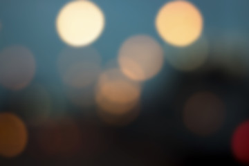 Defocused city night soft blur bokeh background of car light with a form of  love red shape, in retro and vintage style