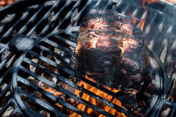 pork brisket of flame grill with charcoal