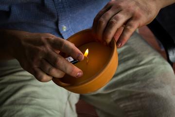 Man lighting candle