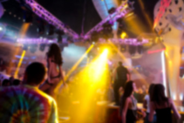 Blurry night club dj party people enjoy of music dancing sound with colorful light. club night light dj party Ibiza club. With Smoke Machine and lights. Dark background.