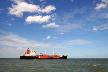Lpg tanker at sea and blue sky background , the ship is a gas carrier