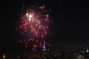 The Empire State Building is seen behind the Macy's 4th of July Firework Show in Manhattan, New York City
