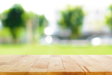 Wood table top on blurred green nature background