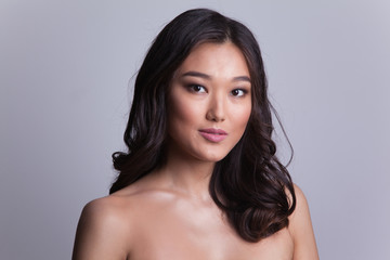 Portrait of a beautiful asian woman with naked shoulders.