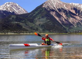 Man is racing in a kayak