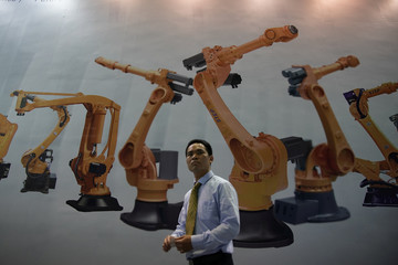 A man walks past a billboard at 2017 China International Robot Show in Shanghai