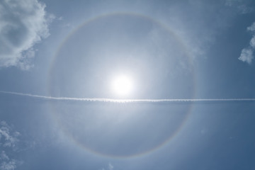 sun halo phenomenon, circular rainbow around the sun