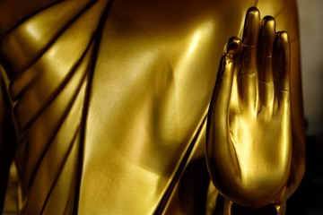 Close up Hand of Golden Buddha Image.