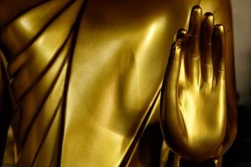 Close up Hand of Golden Buddha Image.