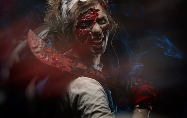 photo of the girl in zombie makeup covered in blood