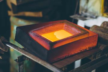 Melting gold at a mill