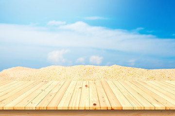Wood table top on beach background,used for display or montage your products