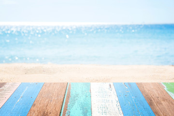 wooden table top on blurred beach background