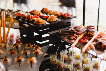 Catering banquet table at reception. Restaurant presentation, molecular gastronomy, haute cuisine, food consumption, party concept.