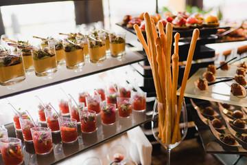 Catering banquet table at reception. Restaurant presentation, molecular gastronomy, haute cuisine, food consumption, party concept.