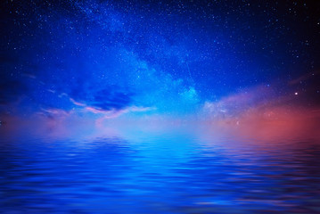 Abstract beautiful night background with blue star sky and water reflection the lake surface