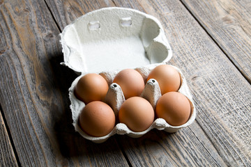 Fresh eggs on wood