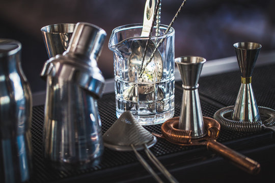 Classic bar cocktail shaker, bartender tools, a set of equipmen in blurred background