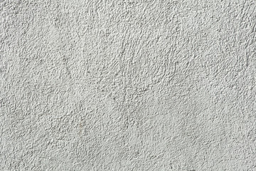 White painted stucco wall.