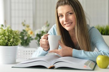 young woman with opened book