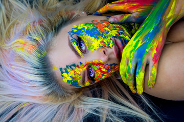 Beautiful blond woman with face painting. Body art.