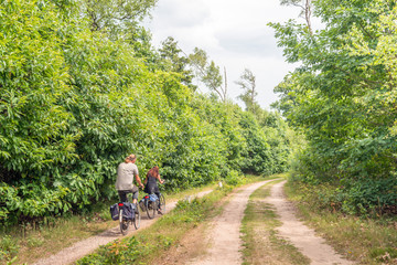 Man and woman cycling in a large nature reserve