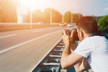 Man photographing highway road