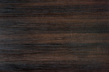 close up view of empty dark wooden tabletop background
