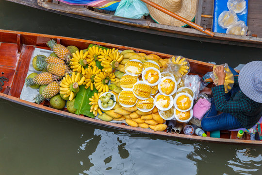 Long-tail boat with fruits on the floating market, Ha long bay, Vietnam