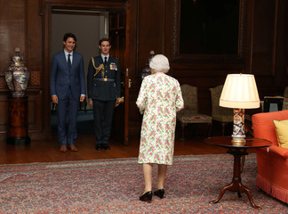 Britain's Queen Elizabeth II greets Canada's Prime Minister Justin Trudeau during an audience at the Palace of Holyroodhouse in Edinburgh