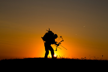 Silhouette of a bow hunter