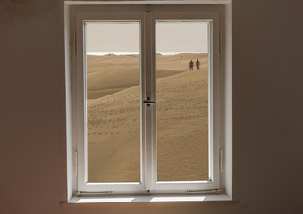 Closed window and a view of a desert on a sunny day