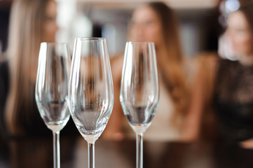 empty glasses of champagne on the background of the girls