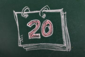 Calendar with date 20th on chalkboard, blackboard texture