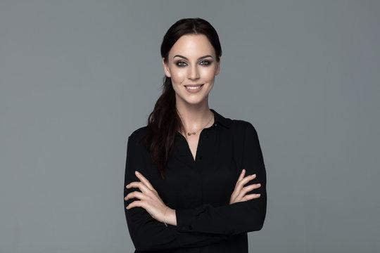 Beautiful smiling woman ib black shirt