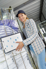 Woman wheeling trolley of clean laundry