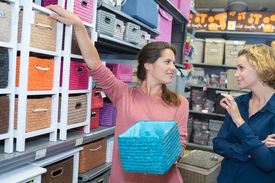 Ladies looking at storage solutions