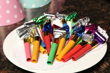 Party blowers on plate. Close up