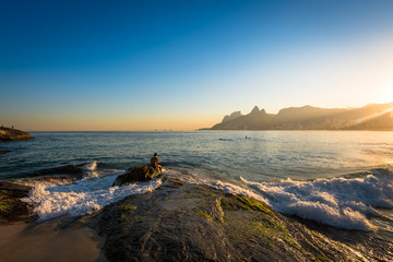 Fototapete - Waves Washing the Arpoador Rock During Sunset in Rio de Janeiro