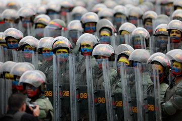 Venezuelan National Guards march during a military parade to celebrate the 206th anniversary of Venezuela's independence in Caracas
