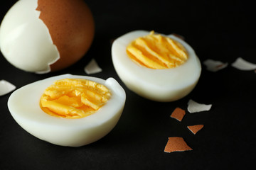 Hard boiled eggs on black background. Nutrition concept