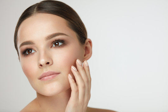 Woman Beauty Face. Female With Natural Makeup Touch Facial Skin