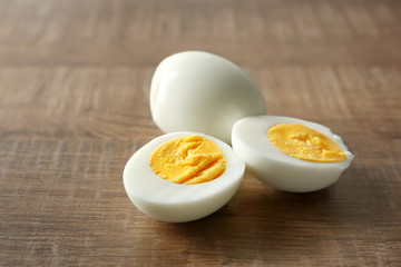Hard boiled eggs on wooden background. Nutrition concept