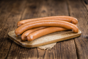 Wooden table with Wiener Sausages (selective focus)
