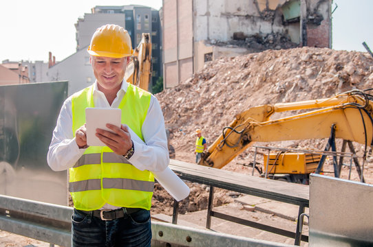 Entrepreneur on construction site using electronic tablet
