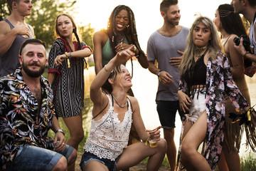 People Enjoying Talking Together at Music Concert Festival