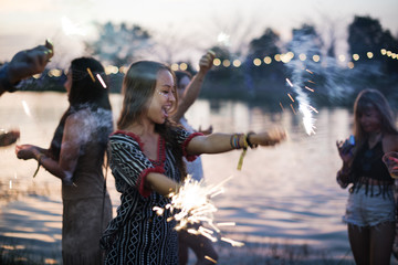 Woman Enjoying Sparkler in Festival Event.