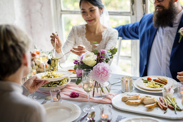 Bride Getting Food From Plate in Wedding Reception