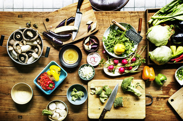 Aerial view of prepare to cook fresh vegetable on wooden table in the kitchen